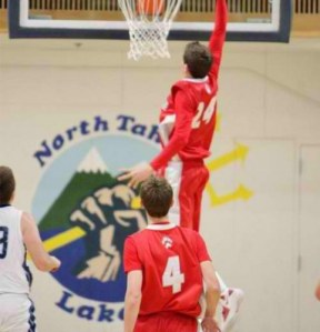 Trent McMullen of Truckee going for a dunk in the Boys Varsity Basketball Game vs. North Tahoe High School