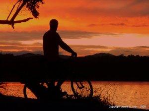 Daniel Herr with a bike a sunset on Stewart Island in New Zealand