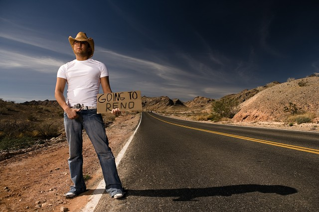 Guy with Cowboy hat and white shirt hitchhiking to Reno in Nevada