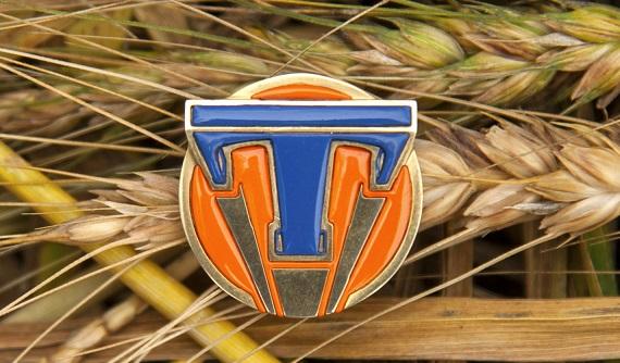 Disney's TOMORROWLAND..Tomorrowland pin ..Ph: Kimberley French..©Disney 2015